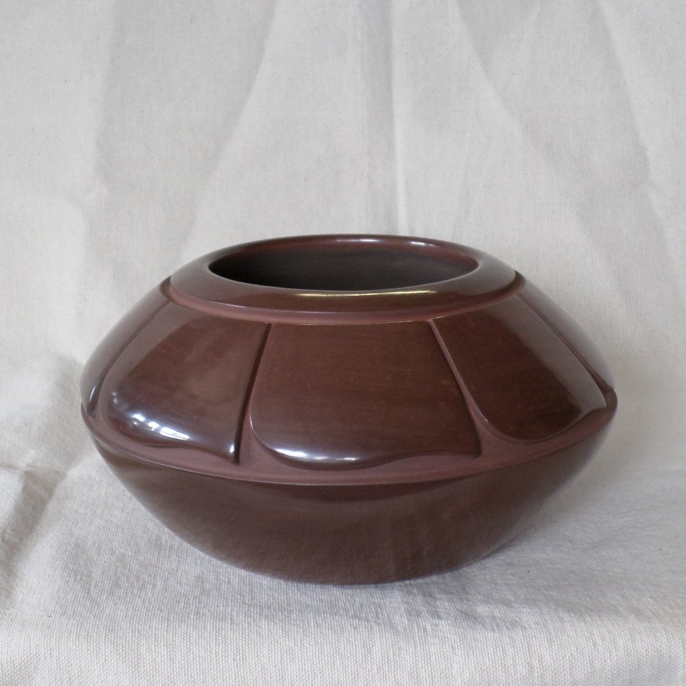 Brown Bowl with Feather Designs     Price: