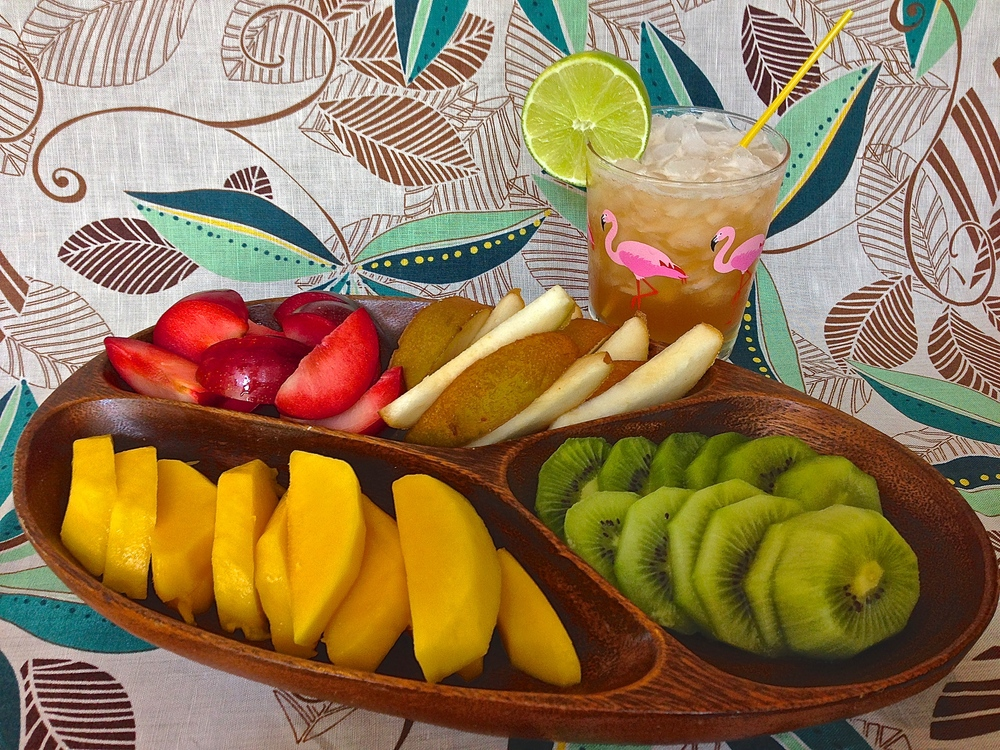 Any colorful mix of fresh fruit can take on a tropical look when you present it simple and bit size.
