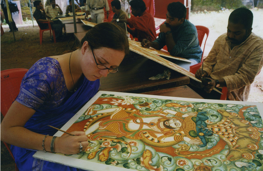 Susanna Fields-Kuehl demonstrating traditional Kerala Mural Painting using natural colors from minerals and plant leaves, South Indian Traditional Artists Festival, Thrissur, Kerala, India, 2004.