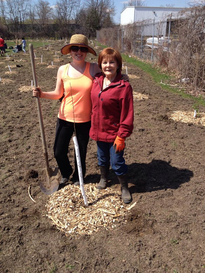 Kristin and Irene Mathyssen planting the last tree - a trembling aspen.jpg