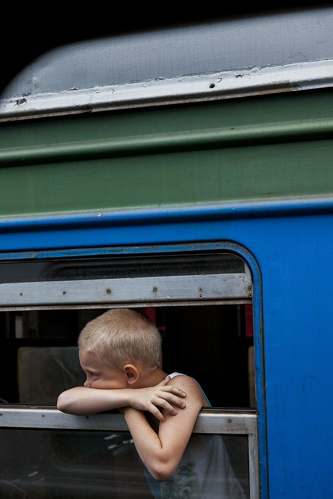 Portrait of a boy on a train headed in the opposite direction. Somewhere in the middle of Siberia.