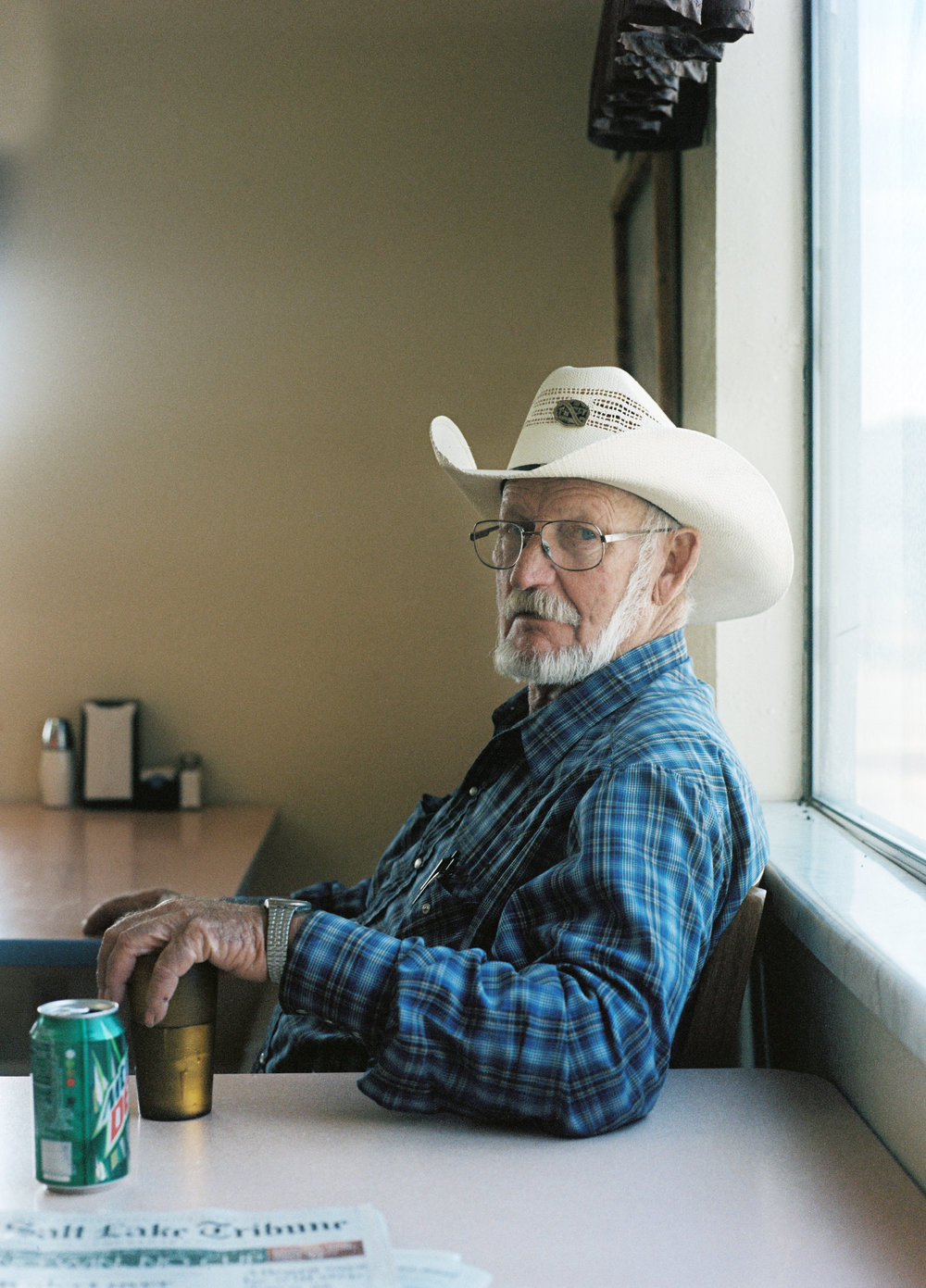 Charlie Strebel the day before he turned 72, sitting in his cafe, Sagebrush Inn, which doubles as a grocery store and inn. Tabiona, population 169 . August 2015.