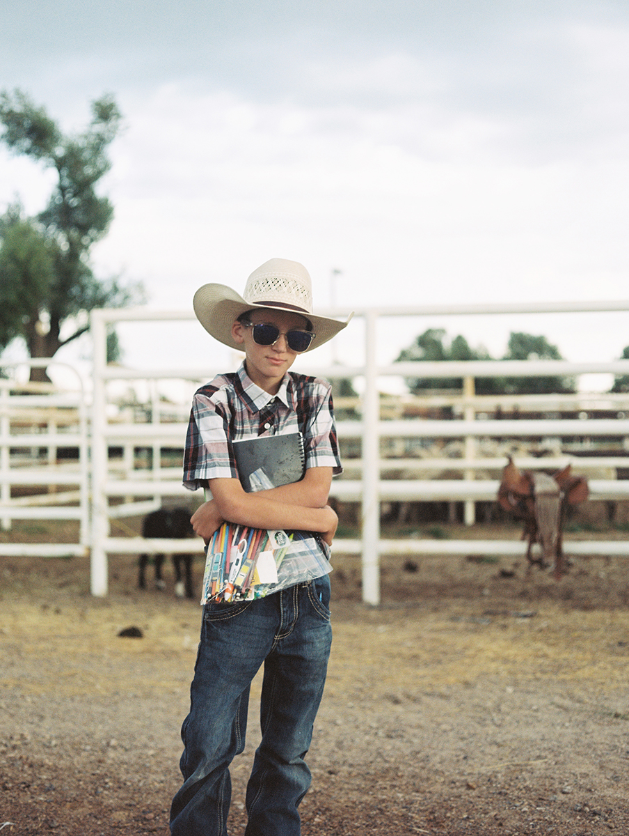 A young boy at the Randolph Rodeo. He doesn't feel like he fits in, he wants to be an artist.  June 2016.