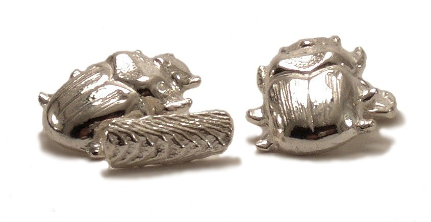 $270 SCARAB CUFFLINKS historically used by ancient Egyptians as talismans and amulets, the scarab symbolized rebirth and renewal. this cufflink is attached with a short link chain to a textured bar that holds the piece in place when worn sterling silver