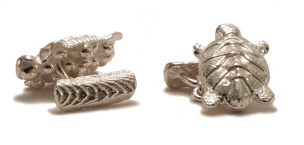$270 TURTLE CUFFLINKS throughout history, cultures have associated turtles with longevity and wisdom. ancient cultures have believed in the myth that the world rested on a turtle's back. this cufflink is attached with a short link chain to a textured bar that holds the piece in place when worn sterling silver
