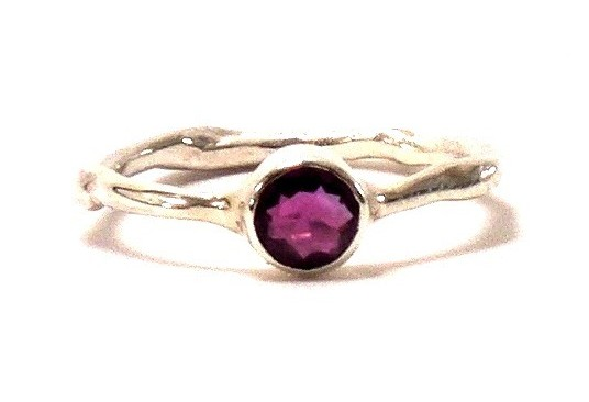 $1650 VIOLETA RING features a beautiful 0.50 ct purple sapphire bezel-set in a delicate branch band Platinum