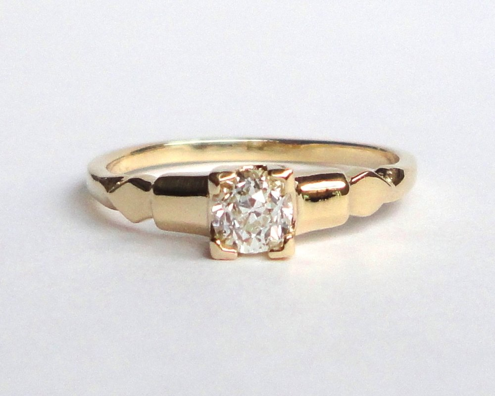 $980  Old Mine Cut Diamond RING centering on a 0.30 ct old mine cut diamond, beautifully set in a four-prong fish tail setting 14K yellow gold