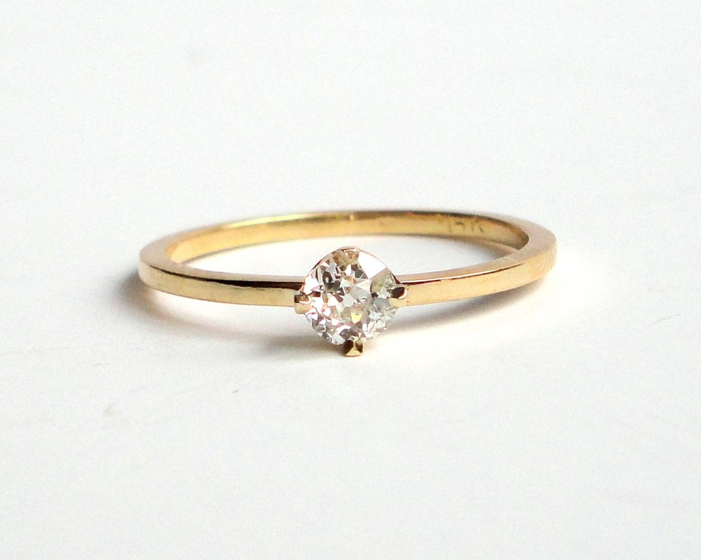 $775   Old Mine Cut Diamond RING  centering on a 0.25 ct old mine cut diamond, beautifully set in a four-prong setting  14K yellow gold