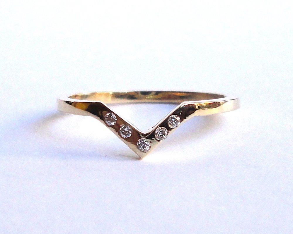 $620  Diamond 'V' RING  flat polished gold band, bead set with six diamonds  14K yellow gold
