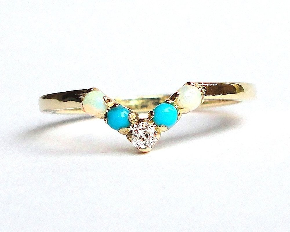 $630  Five Stone V-RING  centering on an old mine cut diamond, accented with two cabochon turquoise and two cabochon ethiopian opals   14K yellow gold