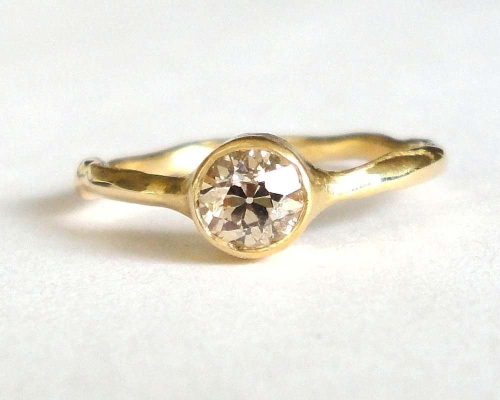 $1325 Old European Cut Fancy Yellowish Brown Diamond RING features a beautiful 0.51 ct fancy yellowish brown diamond bezel set and finished with a polished branch band 14K yellow gold