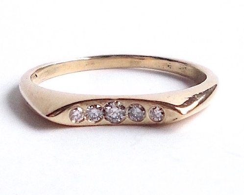 $810 Nela Diamond RING set with five graduated diamonds, in a navette shaped geometric band  18K yellow gold