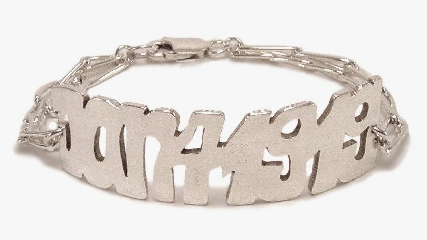 $320 NISHI ID BRACELET inspired by the need to wear an important date in a piece of jewelry in a way that was not engraved, Joanna developed a hand-cut graffiti style plaque and put it on a bracelet sterling silver