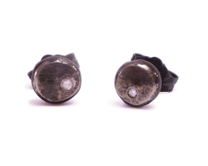 $150  SALVA STUDS  made from recycled silver with a 1.5mm diamond. the oxidized finish of the silver contrasts against the stone, highlighting its brilliance  oxidized sterling silver