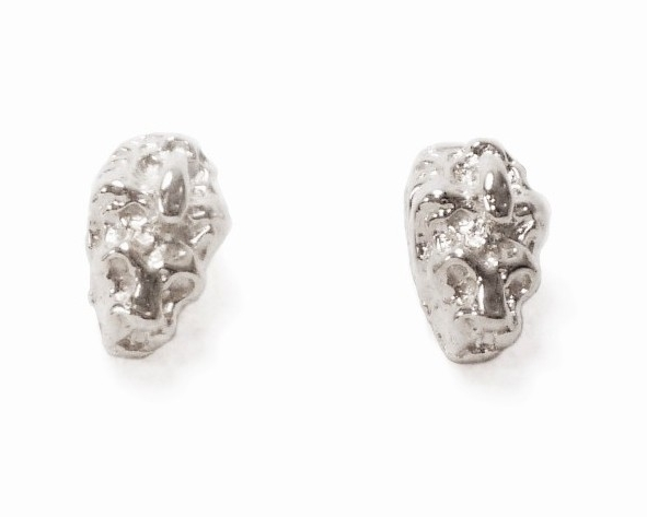 $100 LION HEAD STUDS   measure 6mm x 12mm, with a polished finish that accentuates the lion head's features. a longtime symbol of power and wisdom, the lion studs can add a little roar to your day sterling silver
