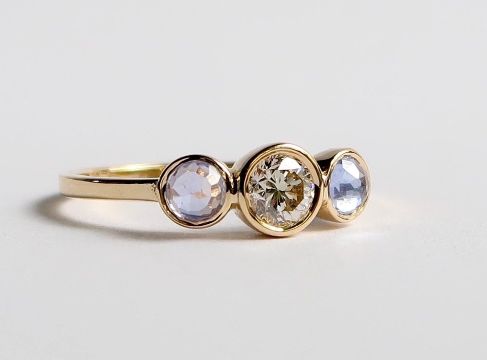 $1485  Diamond and Rose Cut Sapphire RING  a beautiful three stone diamond and rose cut sapphire ring, elegantly bezel set and finished with a flat band  14K yellow gold
