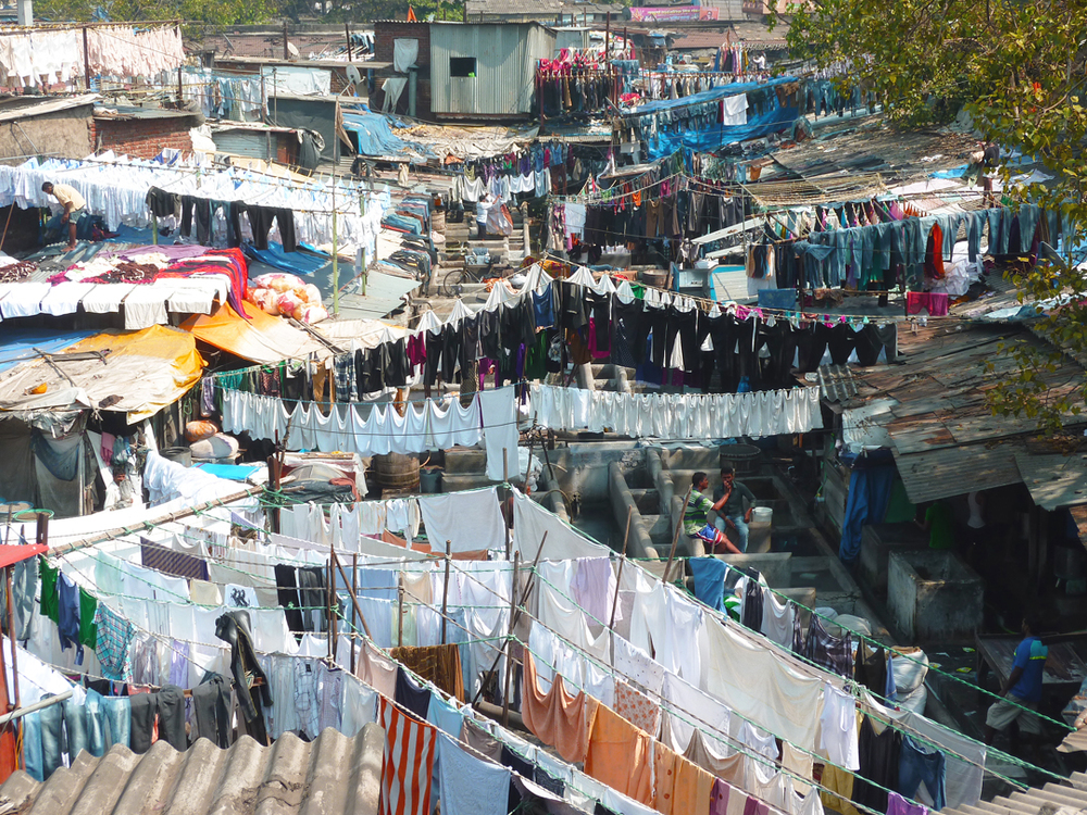 Chaotic or orderly?  Mahalaxmi Dhobi Ghat in Mumbai, which is where thousands of clothes are still washed by hand everyday and is considered to be the  world's largest outdoor laundry .  Source:  Aseem Inam.