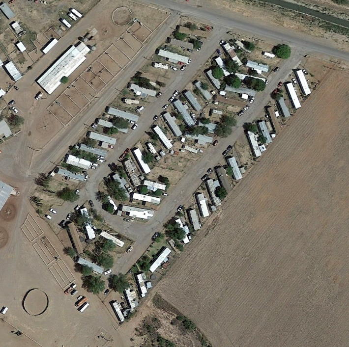 Many of the  colonias  are trailer parks with mobile homes but with little or no public space or public amenities, and are marked by predatory practices of housing finance.  Source: Google Earth