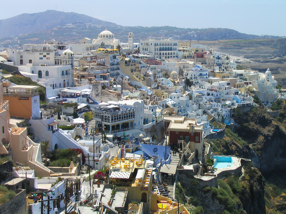 While Santorini is filled stunning natural beauty, it is also overrun with tourism, including hotels, restaurants, shops, and cruise ships and buses that bring thousands of visitors on the small islands.  The main challenge of the Plan was to address the destructive impacts of this model of tourism.  Source:  Flickr user VideoVik [Creative Commons].