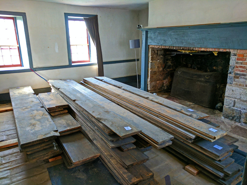 Floorboards cleaned, sorted, stacked and waiting to be relayed