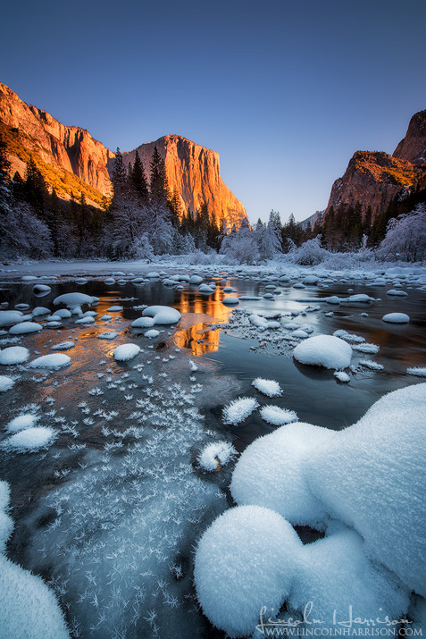 el capitan is lit by morning sunlight over the frozen merced river in yosemite national park