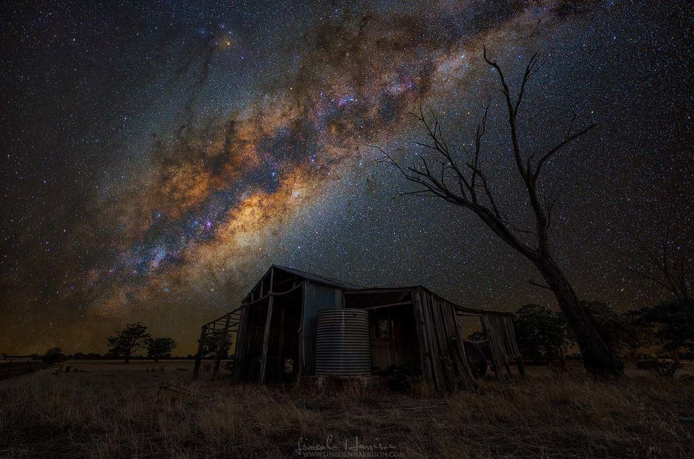 Milky way over old barn