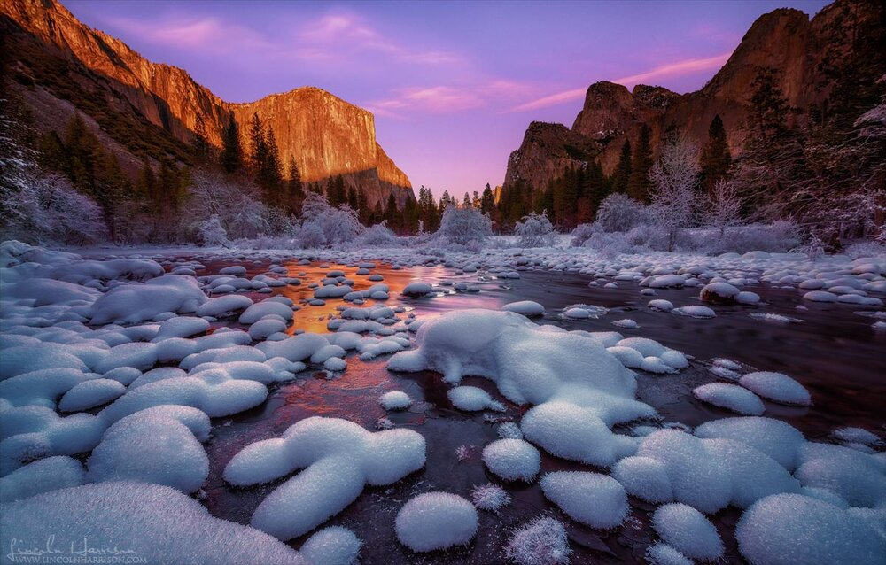Sunset over a frozen Merced river in Yosemite Valley