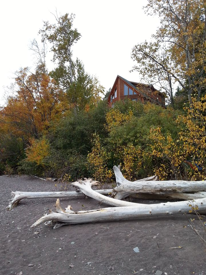 Our lakeside retreat viewed from the rocky beach along Lake Superior