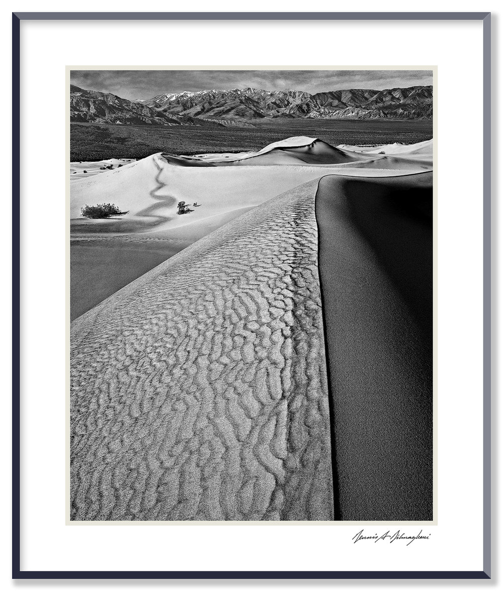 Sand Dunes - Death Valley National Park - California   Photographing on sand dunes is challenging. It's usually windy with sand blowing constantly around your feet and sometimes rising high into the air. Protecting the camera and lens is most important. Positioning tripod legs on sand is difficult.