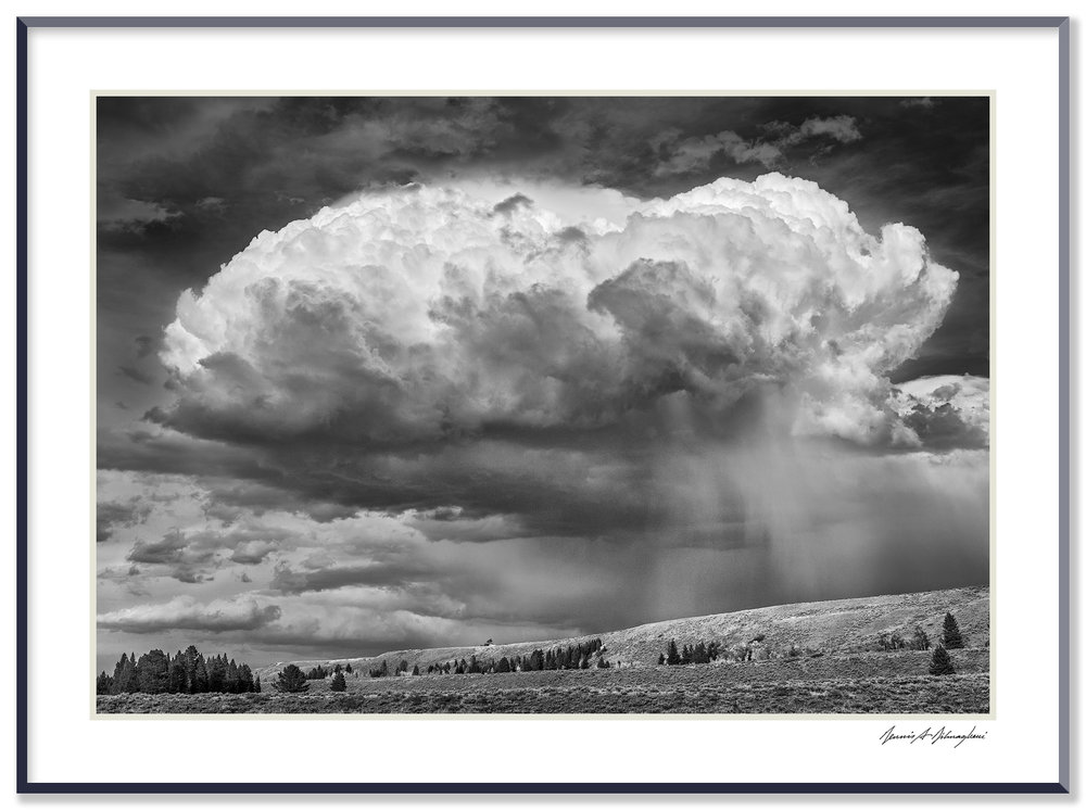 Storm Cloud - Schwabacher Landing - Near Jackson, Wyoming  This remarkable cloud appeared quite suddenly and morphed into a nondescript shape just as quickly.  As the cloud passed overhead, heavy rain poured across a vast swath of land.  Note the single small tree (a black dot in this image) left of center and top of the distant ridge. The white spot adjacent to the tree is a parked SUV - The vehicle provides interesting gauge of scale for the image.