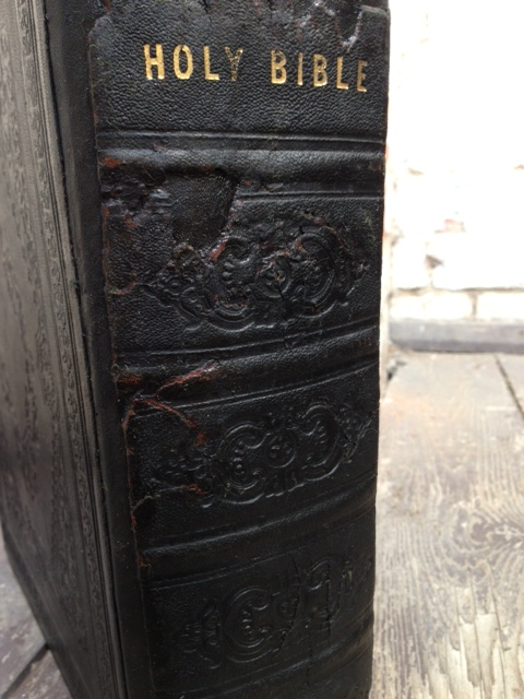 The remnants of the original spine, reinstated on the newly crafted leather spine