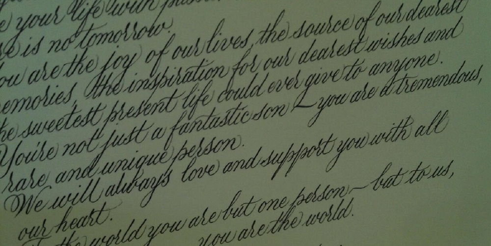 An example of a calligraphy tribute in the front cover of a custom binding.  This example was actually a tribute written by parents to their son on his 21st birthday.