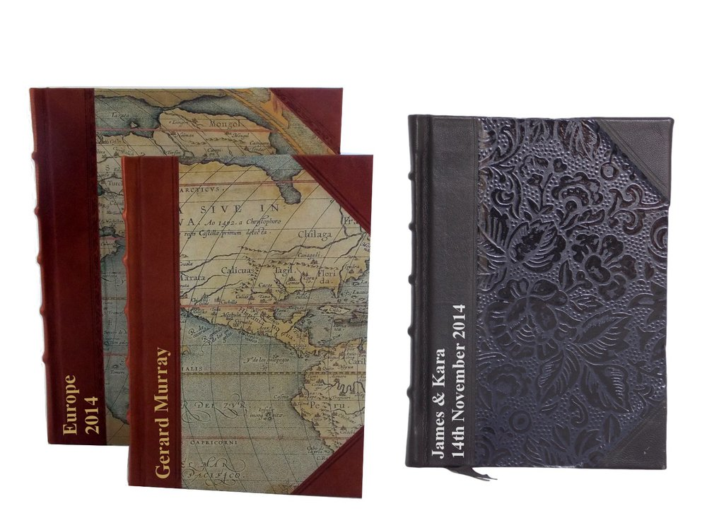 World Maps Journal in 2 sizes (perfect for travel lovers);  Half Leather journal in black floral - both starting from $105