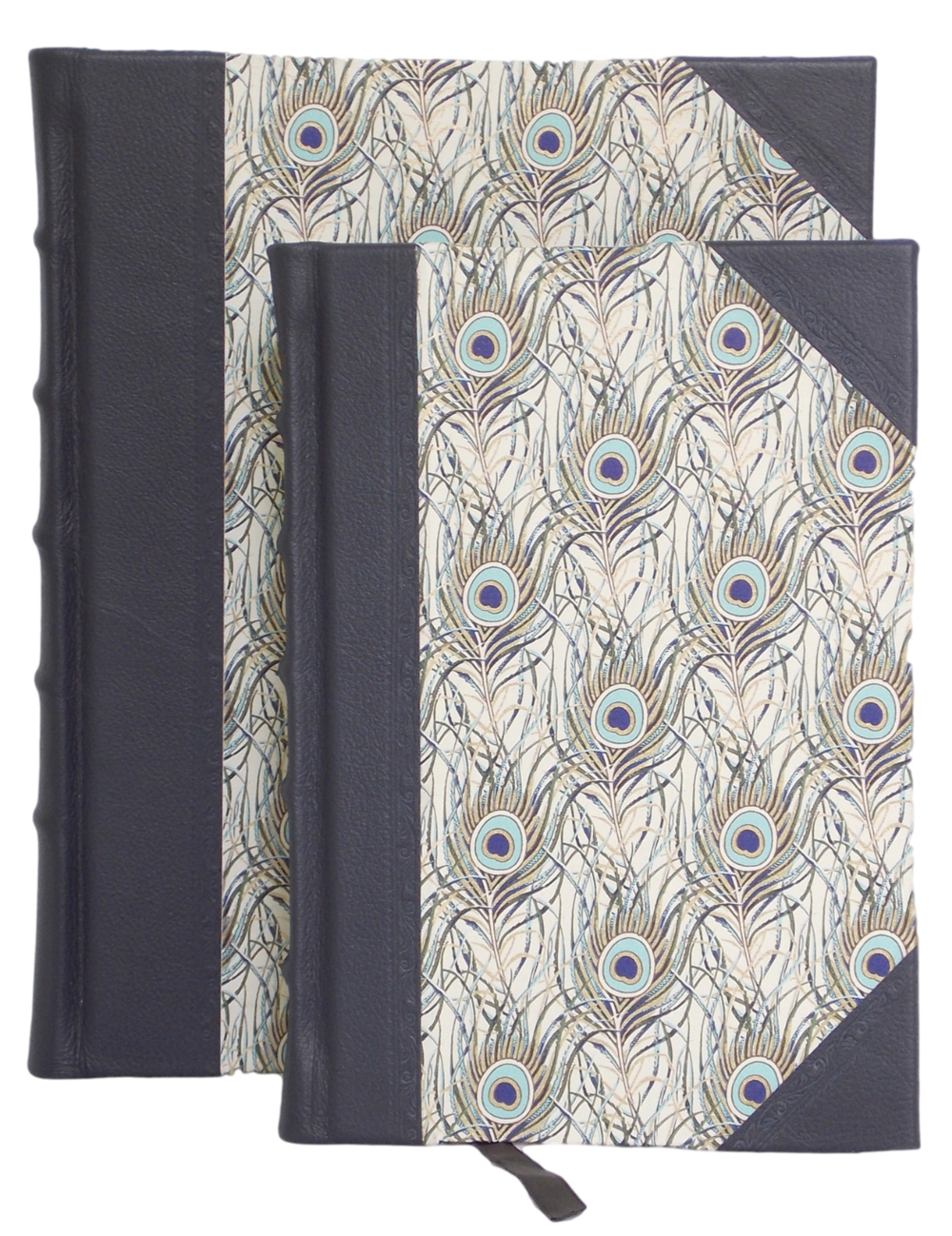 HALF LEATHER JOURNAL IN PEACOCK DESIGN   Fine leather corners and spine with classic raised bands and hand tooling  Italian gold foiled peacock feather design sides.  Cream textured pages with a marker ribbon  Product dimensions: small (22cm x 14cm - 84 leaves),  large (26cm x 20cm - 100 leaves)