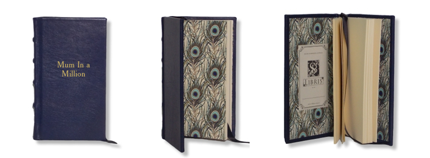 Product Featured:   Slimline Leather Journal in Navy  $75.  God Embossing of title in Cheltenham Old Style font (embossing $25)