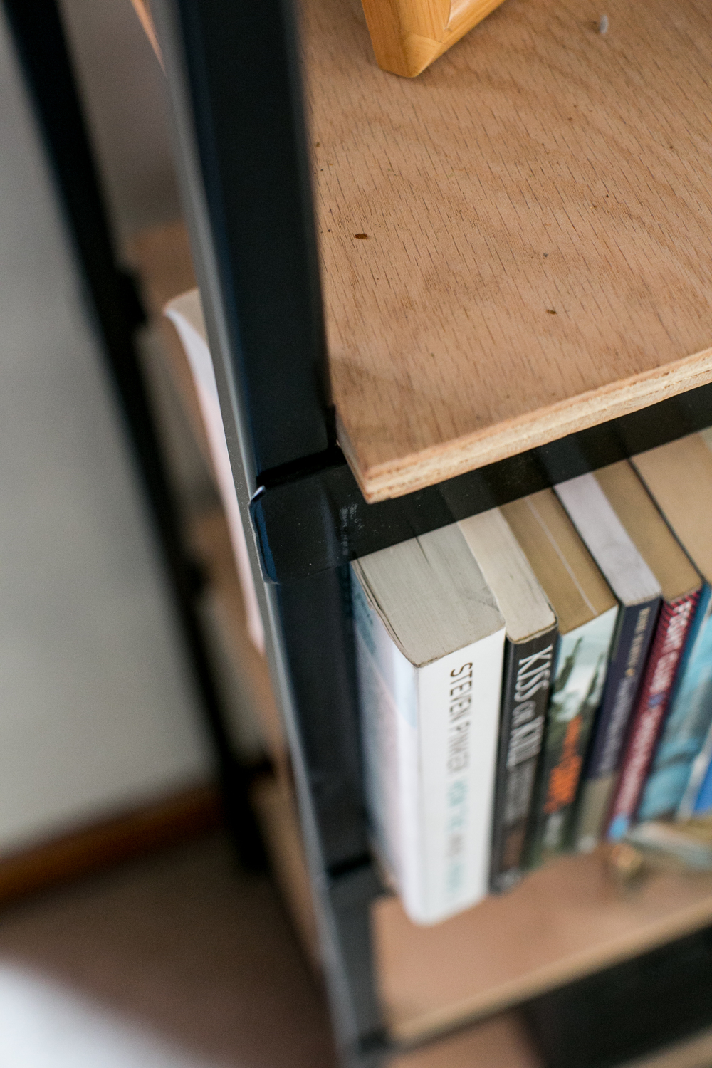 Fully re-claimed iron and ply bookcase.  Simple yet functional.  Beautiful and big.  TomCat Customs.