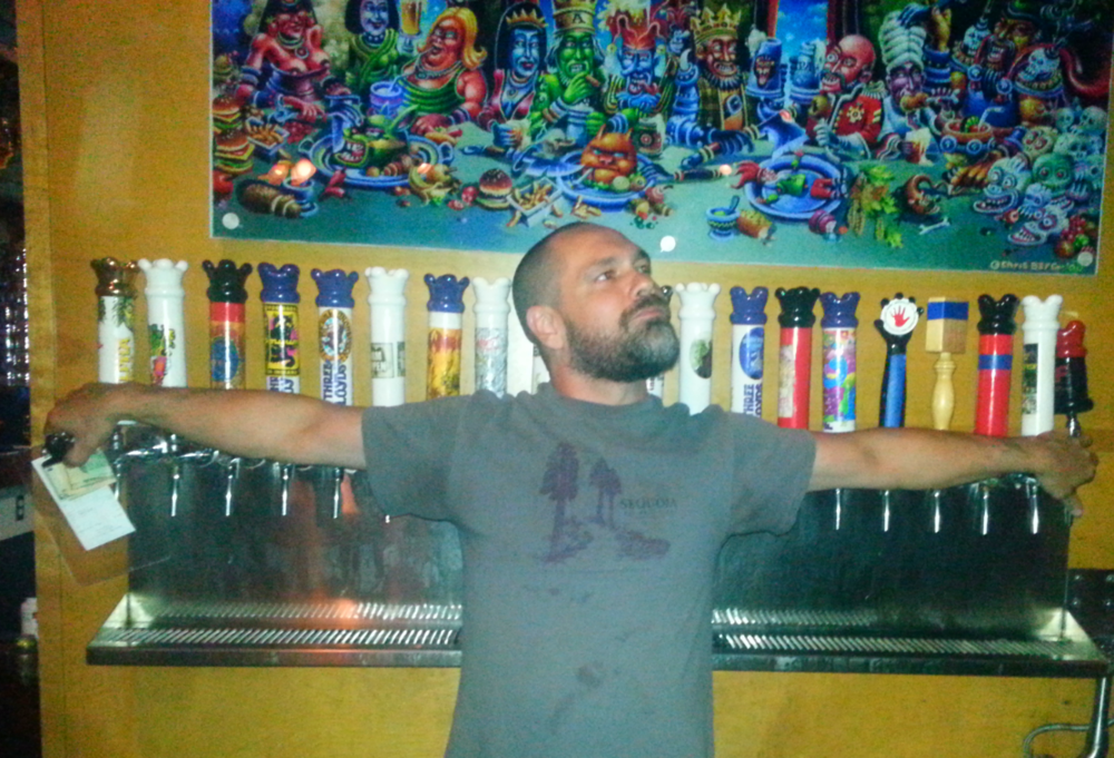 A Three Floyds bartender and his many brews / Photo by Michael Mackie