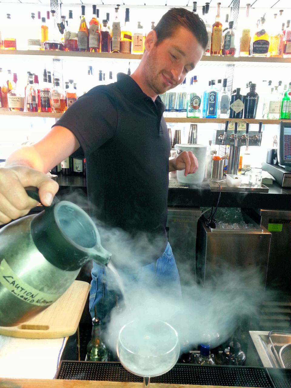Beverage manager John Buckhalt uses liquid nitrogen to ensure a frosty glass / photo credit: Michael Mackie
