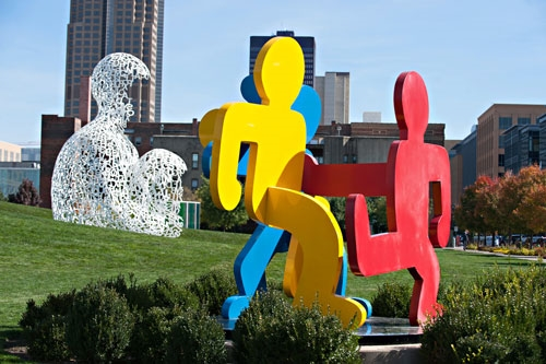 A breathtaking view of the Pappajohn Sculpture Park. Foreground sculpture by Keith Haring / photo by Mindy Myers
