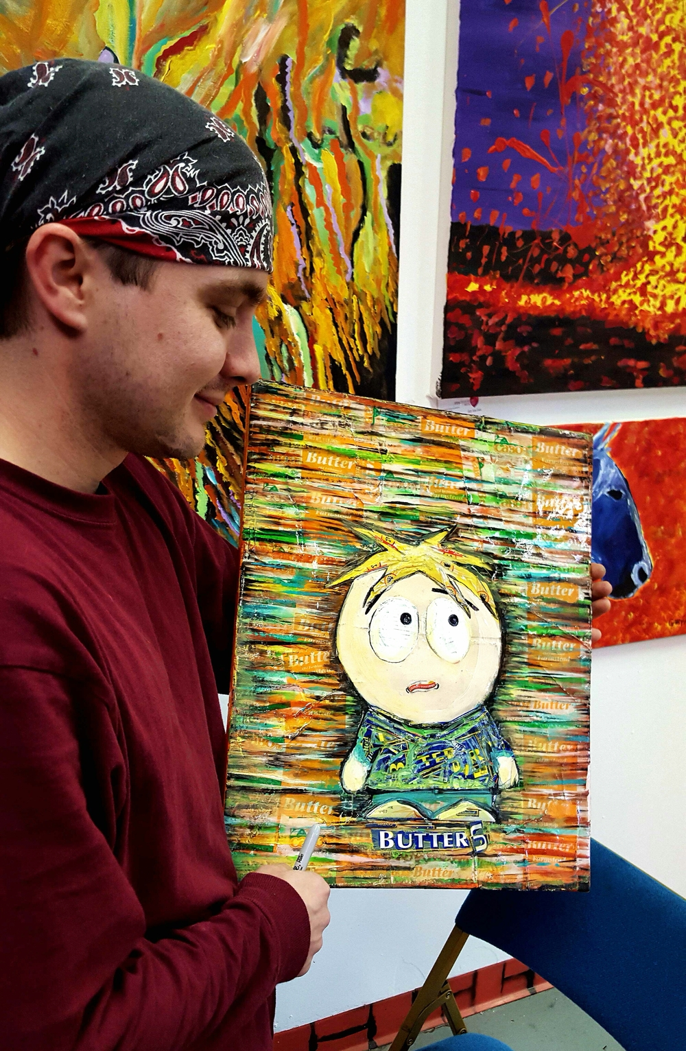 "Mankus holding a painting of the ""South Park"" character Butters made out of -- what else? -- butter stick wrappers."