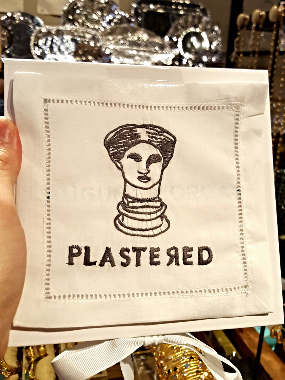 "Who doesn't love a tasteful,   embroidered   cocktail napkin? It makes getting ""plastered"" that much more appealing."
