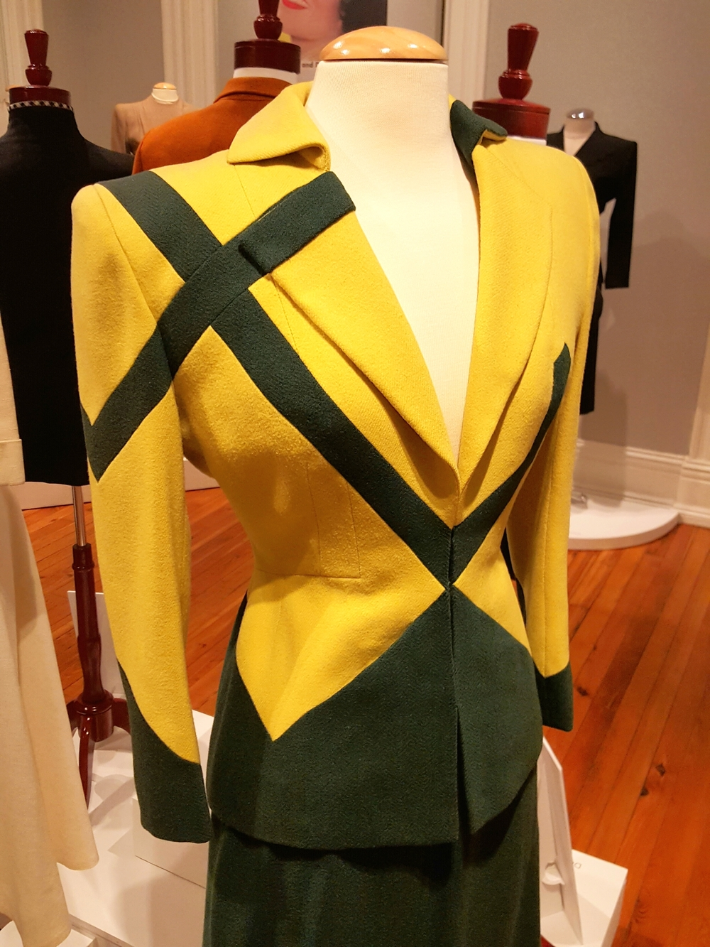 This bold yellow/green suit was featured in the 1947 film LADIES MAN and designed by Mary Kay Dodson. It was a black and white movie -- alas, viewers could never appreciate the delicious chartreuse color.
