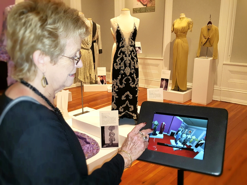 Each room in the exhibit has interactive touch screens. Patrons can view movie clips that feature the costumes on display.