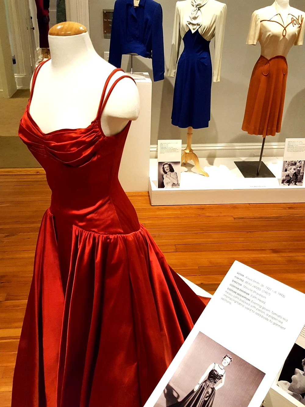 "A tomato-red evening gown by Edith Head, from the 1957 film ""Beau James""."
