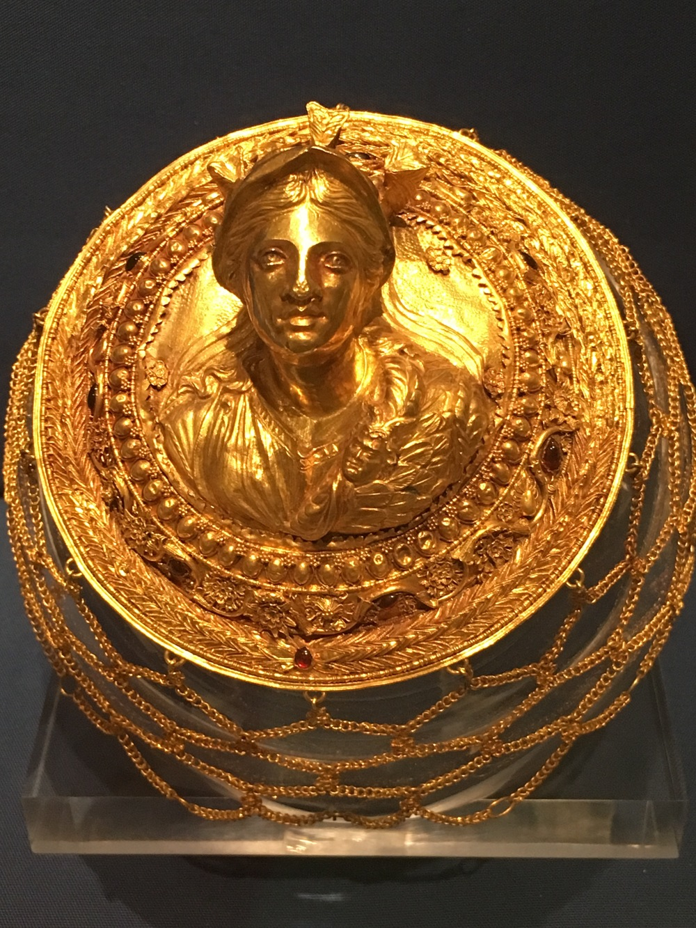 Gold open wormen's hair net with a medallion
