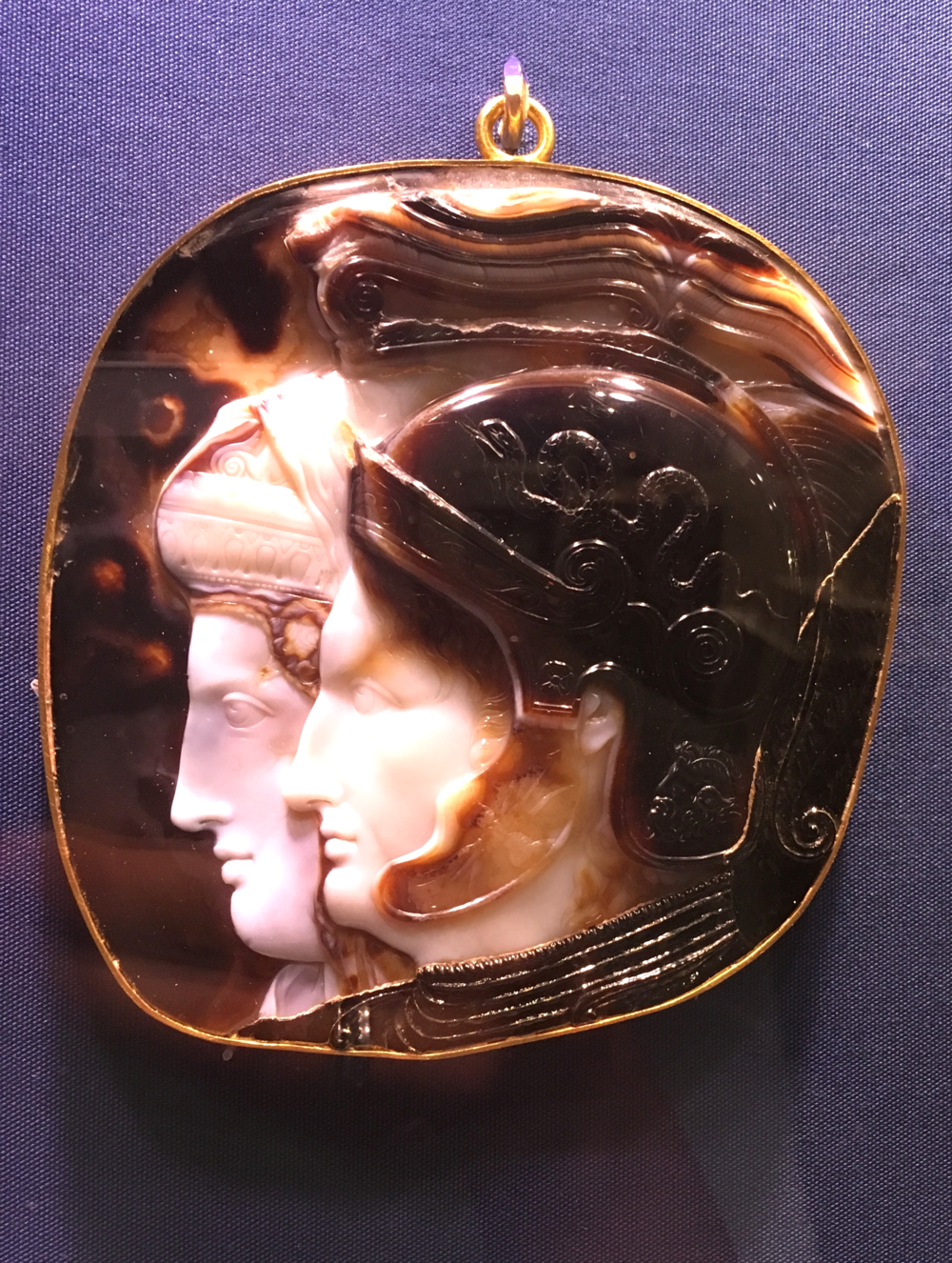 Onyx cameo set in gold hoop. Greek (Ptolemaic), Early Hellenistic period, 278-270/269 B.C.. Large, showy cameo portrays Ptolemy II Philadelphos and his sister-wife Arsinoe II.