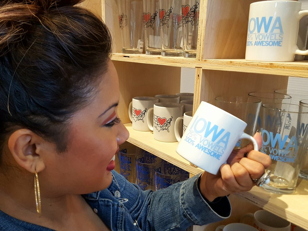 "Shopper Lyra Bristow chuckles at just the perfect coffee mug. ""Iowa: 75% Vowels, 100% Awesome"""