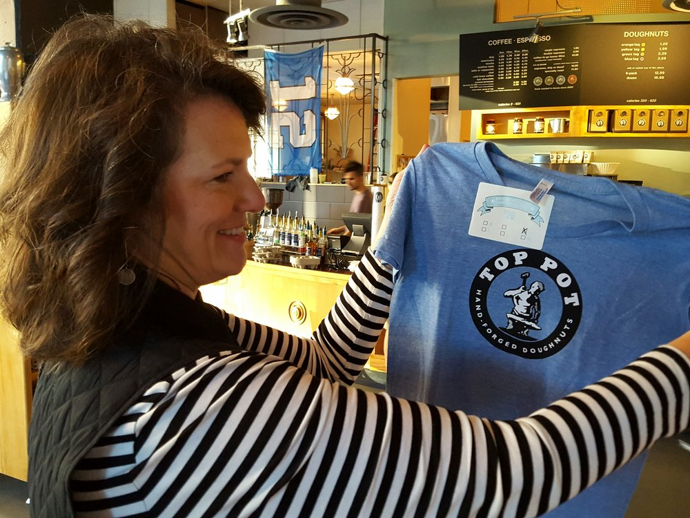 Customer Maggie Brower checks out Top Pot's merch. Image: Michael Mackie.