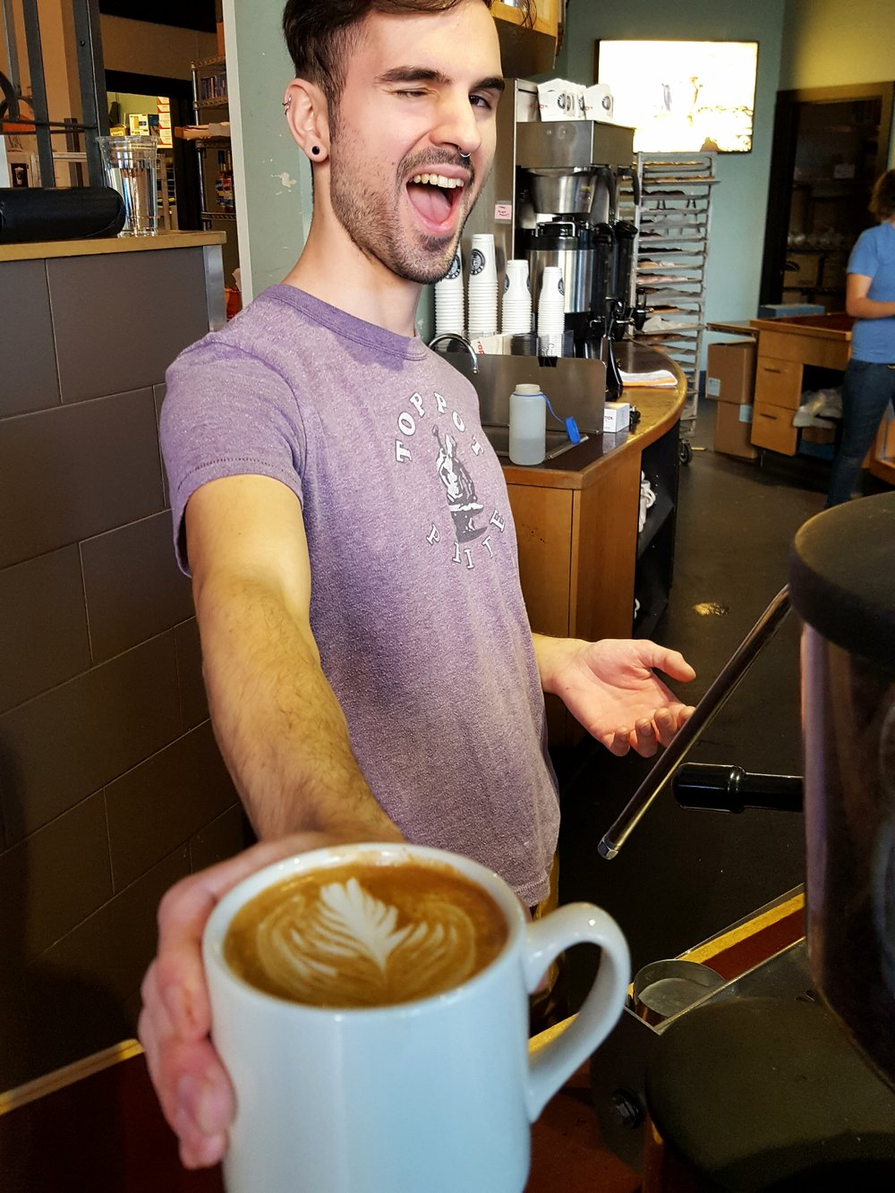 Top Pot barista Christopher smiles