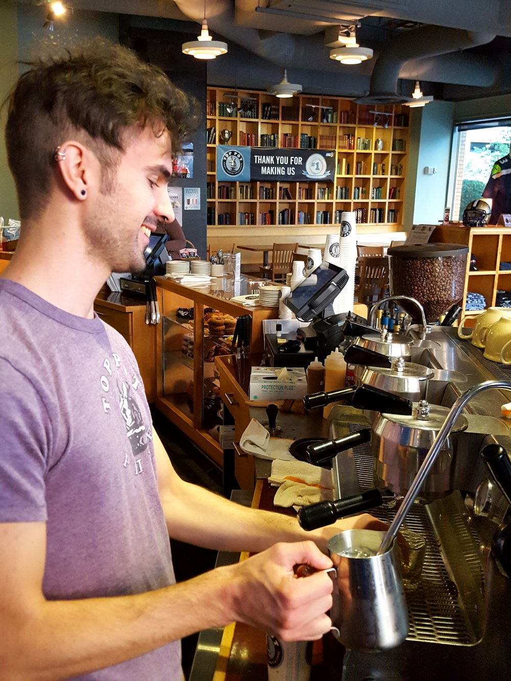 Top Pot Seattle barista Christopher at work.
